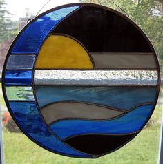 Moon and sun over water round stained glass panel / suncatcher. $55.00, via Etsy.
