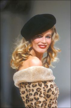 Claudia Schiffer. Black and leopard shirt with black beret