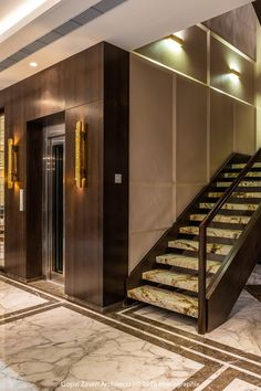 These high-end villas in Surat offer the perfect solution- with their elaborate gold panelling and clever exaggeration o. Home Stairs Design, Modern House Design, Home Interior Design, Modern Interior, Elevator Lobby Design, Halls, Lift Design, Entrance Design, Facade House