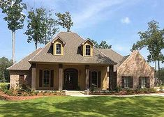 French Country Acadian House Plan 56301SM, built and beautiful.   4 beds plus bonus over garage.   #readywhenyouare