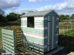 Shed with pallet fence