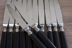 This is a set of 12 Christofle ebony knives available on www.frenchvintagehome.com