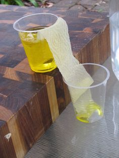 Walking Water- Science experiment for young children. Please tell me that yellow liquid is food coloring! ;)