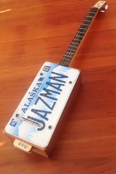 Cigar Box Guitar, License plate resophonic. Made from recycled cedar fencing with custom maple neck and oak fretboard. Tom Thompson - Primitive Acoustics