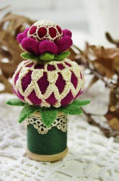 Magenta wool balls covered with pieces of vintage doily sections by woolly  fabulous, via Flickr