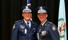 Superintendent Peter Thurtell accepts a Commissioner's Commendation from Commissioner Andrew Scipione.