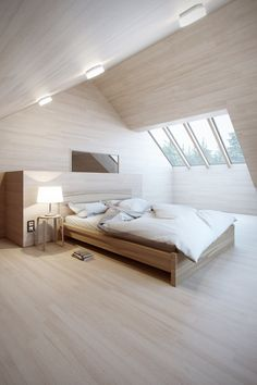 Wood, wood everywhere lets the simplicity of this bedroom design shine.