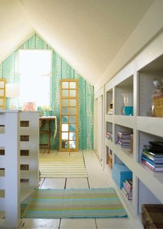 Turquoise and white open plan shelving in attic