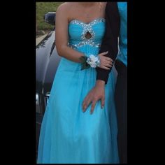 Beautiful Mint/Blue/Baby Blue prom dress I wore this dress last year to prom, and it was beautiful! I'm in love with this dress, and once I saw it, I HAD to have it! I'm 5'1 and I wore 4/5 inch heels with it. I'm also a 34B. If you have any questions, just let me know!  only worn once and now it's just sitting in my closet! Someone put it to use! Price is negotiable. Dresses Prom