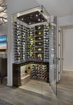 - Love the glass walls and temperature regulated aspect of the cellar - Would want to look more classic and timeless on the inside Glass Wine Cellar, Home Wine Cellars, Wine Cellar Design, Wine Cellar Modern, Under Stairs Wine Cellar, Wine Cellar Basement, Modern Home Bar, Home Bar Designs, Wine Display