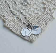 Africa Necklace Sterling Silver Adoption by SceneNotHerd on Etsy, $50.00. Profits go toward helping a family adopt from the Democratic Republic of Congo