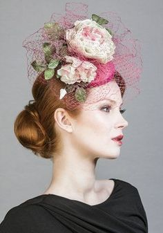 fascinator with flowers and birdcage veil by Rachel Trevor Morgan
