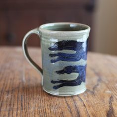 Green blue mug with two running greyhounds by Sarah Regan Snavely