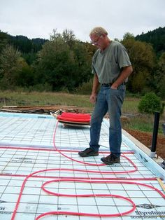 Picture of Continue Laying Out the Entire Space. Hydronic Radiant Floor Heating, Hydronic Heating, Water Heating Systems, Infrared Thermometer, Concrete Slab, Radiant Heat, Story House, Solar Panels, Outdoor Blanket