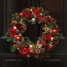A luxurious fresh Christmas wreath of fresh scented pine, fragrant cinnamon and pine cones which incorporate the classic colours of the festive season.