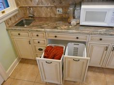 Roll out bin drawers, used for hampers near laundry room area. Kitchen design & remodeling by Danilo Nesovic, Designer · Builder (dndb.info)