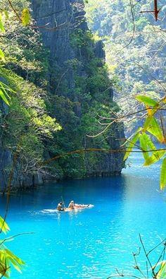 Sun bathing on a bamboo raft at Kayangan Lake in the Coron Islands of Palawan, Philippines