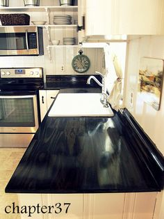 DIY wood counter tops pine boards, glue and screw from underneath.black stain, 6 coats of floor grade sealer Diy Kitchen Shelves, Kitchen Redo, New Kitchen, Kitchen Ideas, Kitchen Updates, Kitchen Black, Kitchen Tile, Kitchen Cabinets, Diy Wood Counters