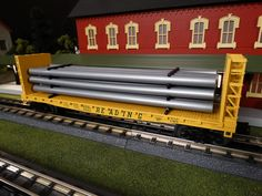 MTH Spotlight  http://mthtrains.com/railking/spotlight/02_2015/d In the yard today the just arrived 2015 MTH RailKing O Gauge Flat Car with Bulkheads and Pipeload. Featured in the 2015 Volume 1 Railking & Premier O Gauge Trains Catalog these flat cars come in Reading 30-76590, CP Rail 30-76589, TTX 30-76591, and Long Island 30-76588. The RailKing Flat Car with Bulkheads operates on O-31 Curves and these 2015 models have a MSRP of $54.95. Ask your MTH Dealer about getting one this weekend.