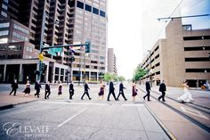 Denver wedding with Emily and Eric at The Grand Hyatt-Elevate Photography    City wedding with wedding party walking through an empty cross walk