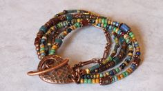 I love these colors.....Beautiful Boho Multistrand Bracelet Featuring Picasso Finished Czech Beads