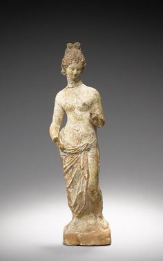 A Greek terracotta figure of Aphrodite. South Italy, circa 3rd Century B.C.