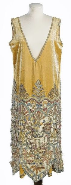 Callot Soeurs Cocktail Dress, 1920s. Honey-coloured velvet trimmed with gilt lace-embroidered skirts, with deep V-shaped decolleté.