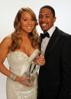 Mariah Carey Photos - Singer Mariah Carey and actor Nick Cannon pose for a portrait during the People's Choice Awards 2010 held at Nokia Theatre L.A. Live on January 6, 2010 in Los Angeles, California. - People's Choice Awards 2010 - Portraits