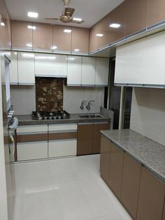 This apartment in Mira Road,Thane is complete with modern interiors including a high gloss laminate kitchen with premium fittings. This spacious home is designed with elegant theme and painted with light colours. Kitchen Cupboard Designs, Kitchen Room Design, Best Kitchen Designs, Modern Kitchen Design, Kitchen Layout, Interior Design Kitchen, Kitchen Wardrobe Design, Wardrobe Interior Design, Modern Kitchen Interiors