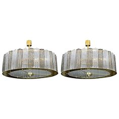 Lovely Pair of Murano Glass Chandeliers | From a unique collection of antique and modern chandeliers and pendants at https://www.1stdibs.com/furniture/lighting/chandeliers-pendant-lights/