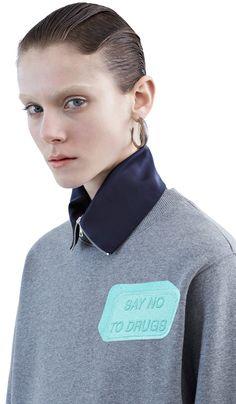 Bird cropped fleece sweatshirt with an embroidered slogan patch #AcneStudios #PreFall2015