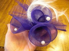 Follow these simple step-by-step instructions to make your own crin flower to trim your handmade fascinator.