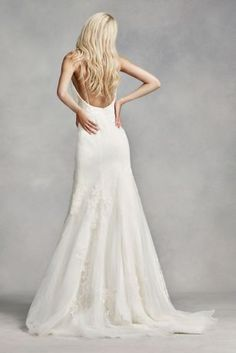 This clean silhouette is both romantic and sexy. Featuring 3D organza flowers applied to tulle and veiled over lace, a spaghetti strap camisole neckline and a plunging back , this wedding dress would work well at an outdoor wedding in the country. White by Vera Wang, exclusively at David's Bridal. Also available in Extra Length. Check your local stores for availability. Chapel train. Fully lined. Imported. Zipper Back. Dry Clean only. Cherish your wedding dress forever with our Gown