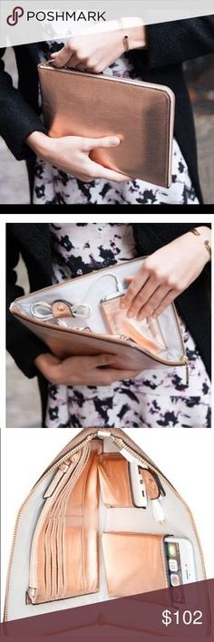 IVANKA TRUMP purse cell clutch w power bank  ✅HUGE SALE. ROSE GOLD COPPERISH Color currently THIS LISTING ONLY!!✅Ivanka Trump Purse /TechClutch wPower Bank -Rio SleeveRoseGoldColor-1st 3pics stock2demonstrate functionality other photosRactual product NEW IN BOX,AUTH, ret Val $101.504th pic color best can also B seen unde MEETTHEPOSHER. silver in SEP listing❌no white coloringInPurse❌✅will fit iPhone 6+7+ as in pic, standard ipad is same size so a lilTOObig⭐️incLDS BAG⭐️power ban