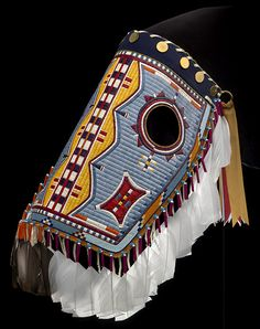 Assiniboine/Sioux horse mask, 2008. Montana. Made by Juanita Growing Thunder Fogarty (Assiniboine/Sioux, b. 1969). Porcupine quills, seed beads, brass buttons, feathers, and hide. Photograph by Ernest Amoroso, NMAI. (26/7046)