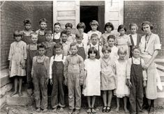 """The capture of the """"real"""" farm life in Foster, Missouri in the 20's. The poor children, barefoot, with dirty clothes, impetigo on their little faces and the look of the school marm are classic to me. Farm School: 1920s"""