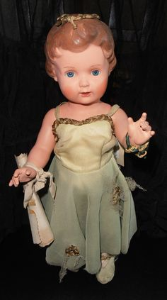 German doll - I had one just like this(different dress) and I loved it. The body is made out of Tortoise Shell.
