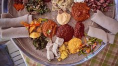 """We travelled to Ethiopia for two weeks and filmed the making of injera, false banana and coffee as well as everything else we saw.  Please watch, enjoy and visit this amazing country!  Created by: www.theperennialplate.com In Partnership with Intrepid Travel: http://www.intrepidtravel.com/foood/ Filmed & edited by: Daniel Klein ( twitter.com/perennialplate/ ) Mirra Fine ( twitter.com/kaleandcola/)  Music: """"Eshururu"""" by Dereb The Ambassador: http://derebtheambassador.com/"""