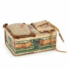 circa 1800, the box naively constructed of paper and board and with watercolor decoration in green and brown, box lid features an embroidered pin cushion and needle case of wool and paper, interior with early wallpaper lining. Box was likely made by Sara Mitchell (b. about 1818). The 1880 US Federal Census shows Sarah living in Forbush, Yadkin, North Carolina in the household of Isaac A. Jarratt and Ellin Jarratt. 2.5 x 6 x 4.25 in. Acquired from the Estate of Dunreath Jarratt Edwards of ...