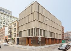New York firm Alloy has completed a row of skinny houses in Dumbo, Brooklyn with a concrete, wood and steel facade meant to reference industrial buildings