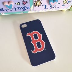 New! Boston Red Sox Baseball iPhone 4/4S Case Navy New! Boston Red Sox Baseball iPhone 4/4S Case Navy. Purchased at a game while visiting Fenway and never used. Brand new without packaging..great condition. Minor imperfections are not noticeable and are from factory. Item has been in storage since I got my new iPhone. Please ask any and all questions prior to purchasing. If you need more pics, just ask! 😍⚾️ Boston Red Sox Accessories Phone Cases