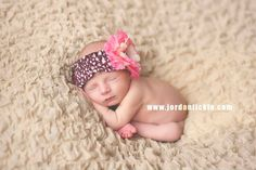 Sweet newborn girl. Pink and brown headband. Sleepy frog newborn pose. www.jordantickle.com  Tickle Photography