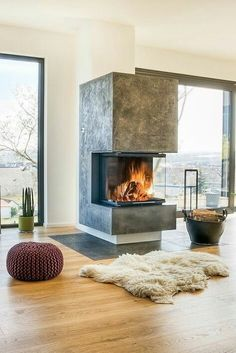 The 70 Best Modern Fireplace Design Ideas - Luxury Interior Fireplace Hearth, Home Fireplace, Fireplace Design, Fireplace Ideas, 3 Sided Fireplace, Hanging Fireplace, Fireplace Pictures, Fireplace Decorations, Farmhouse Fireplace