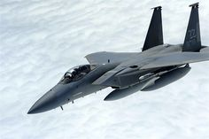 An F-15 Eagle from the 67th Fighter Squadron breaks away from a 909th Air Refueling Squadron KC-135 Stratotanker over the Pacific Ocean Oct. 28, 2013. For more than three weeks, six F-15s from the 67th FS trained with the Singapore air force to improve international cohesion and further develop allied partnerships for the security of the Asia-Pacific region. (U.S. Air Force photo/Senior Airman Maeson L. Elleman)