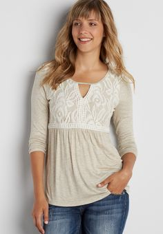 tee with lace overlay and peek-a-boo neckline