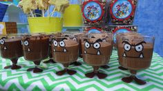 Plastic Goomba cups filled with chocolate mousse. I used paint markers to paint on the faces & feet. Cups purchased at Dollarama. Matching printables by Epic Parties by REVO www.epicpartiesbyREVO.etsy.com