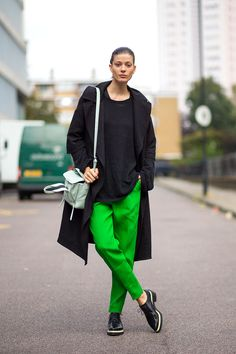 New Shapes & Loose Looks - London Fashion Week Spring 2015, street style, black coat with vivid green trousers.