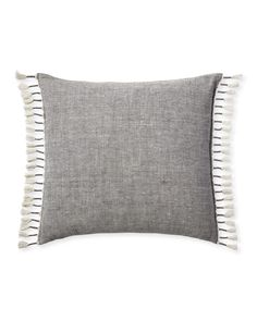 An authentic chambray weave – with white yarns crossing dyed yarns – gives this pillow a soft, washed look. Pure linen keeps it elevated. Nicely finished with hand-knotted tassels along the sides, it has an unexpected vibe that makes the room just a little more interesting.