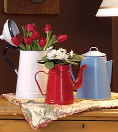 Enamelware is a favorite collectible.  I love the red!