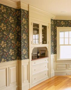 Custom raised-panel millwork in creamy white is a new addition to a Colonial Revival-era house. (Photo: Eric Roth) | Walls Month—31 days of inspiration & advice sponsored by waterputty.com